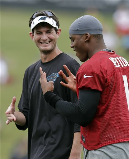 Kenny D passes off some west coast culture to Cam at a recent PAnthers' practice. (photo by Chuck Burton)
