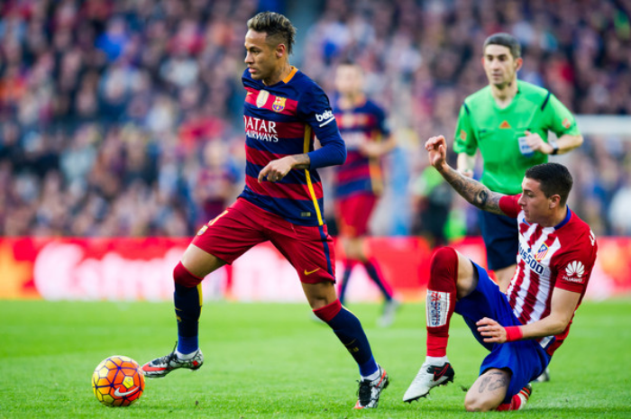 Neymar Santos Jr. of FC Barcelona eludes the defense of Club Atletico de Madrid's Jose Maria during Saturday's La Liga match. FCB prevailed 2-1. (photo by Alex Caparros)