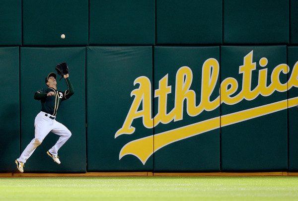 CANHA PRIDES HIMSELF ON BEING A VERSATILE DEFENDER, SPLITTING TIME BETWEEN THE A'S INFIELD AND OUTFIELD. (PHOTO BY THEARON W. HENDERSON)