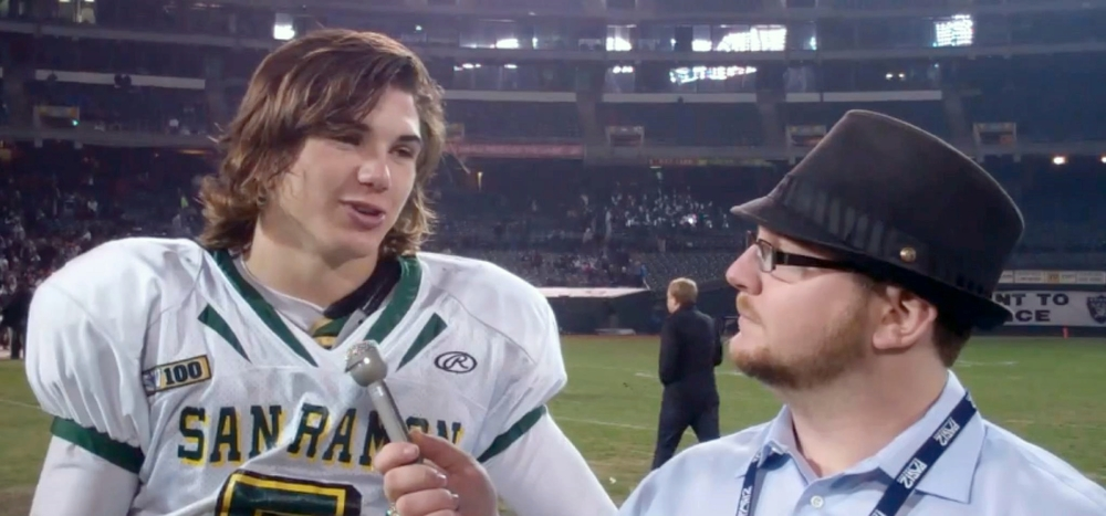 (Zach chats with CAL beat writer Ryan Gorcey during a high school appearance at the Oakland Coliseum)