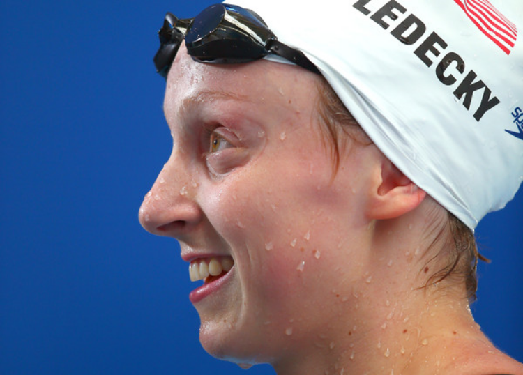 Katie Ledecky smiles after a race in 2015. (photo by Clive Rose)