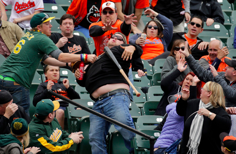 An A's fan lends a helping hand at Camden Yards over the weekend. (photo by Patrick Semansky)