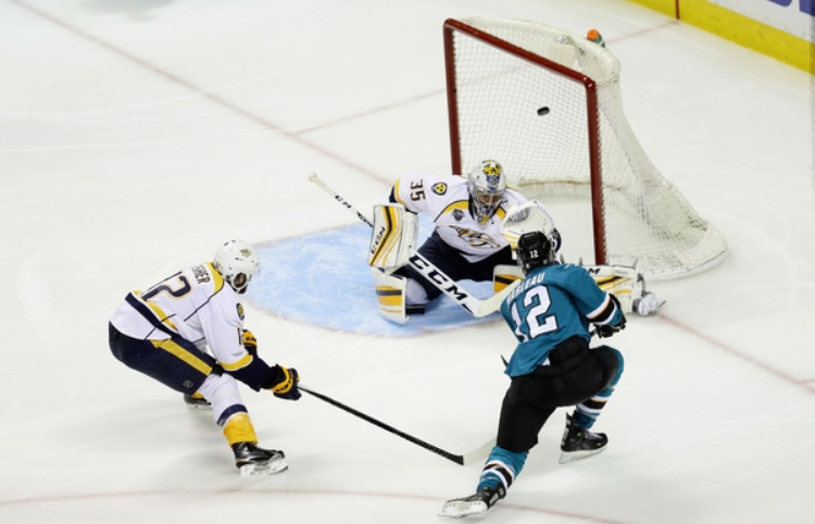 Patty Marleau goes top shelf to light the lamp on Nashville goalie Pekka Rinne. (photo by Ezra Shaw)