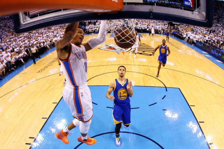 Russell Westbrook registered a 36 point triple-double on Tuesday. Steph Curry finished with 19. (Photo by Ronald Martinez)