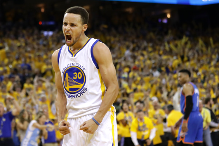 Steph had seven 3's and 36 points in Game 7. (photo by Ezra Shaw)