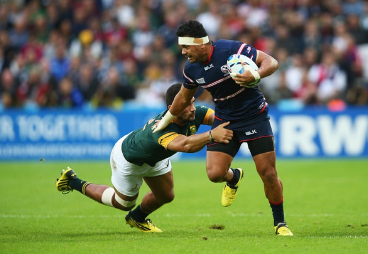 Folau Niua of the Eagles fends off an opponent from South Africa in the 2015 Rugby World Cup in London. The U.S. will play Italy at Avaya Stadium this Saturday evening. (photo by Paul Gilham)