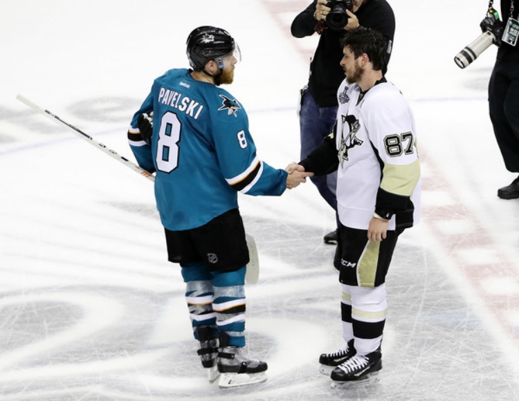 Two hockey greats meet at center ice following a hard fought Stanley Cup. (photo by Ezra Shaw)
