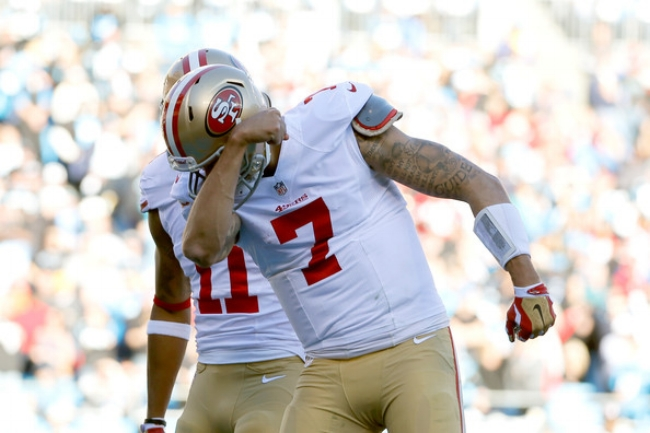 Colin Kaepernick kisses his bicep following a 49er touchdown. (photo by Kevin C. Cox)