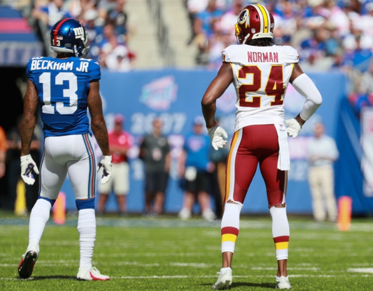 Odell Beckham and Josh Norman battle in New York. (Photo by Michael Reaves)