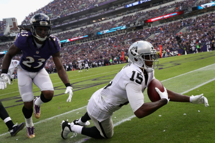Micheal Crabtree's game winning TD in Baltimore. (Photo by Rob Carr)