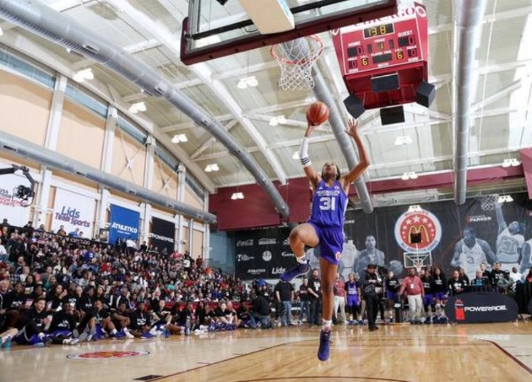 Anigwe rises for a dunk attempt at the McDonald's All-American Dunk Contest in 2015. (Photo courtesy of bearinsider.com)