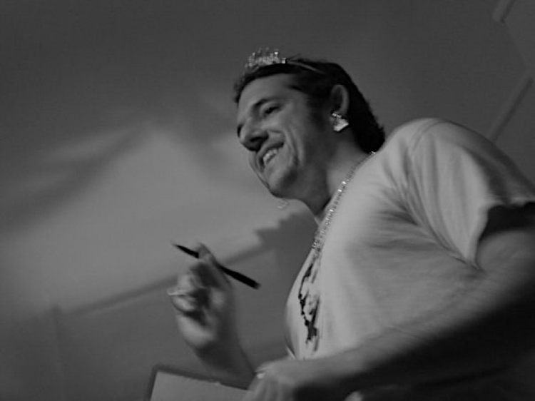 Ned smiles at YG2D's first open mic, held inside his apartment in 2009.