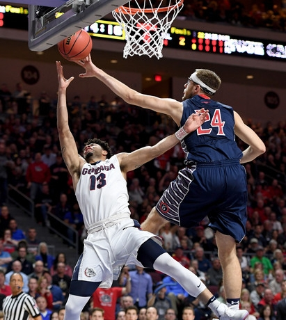 Josh Perkins of Gonzaga and Calvin Hermanson of SMC will play major roles in Thursday's showdown in Spokane. (photo by Ethan Miller)