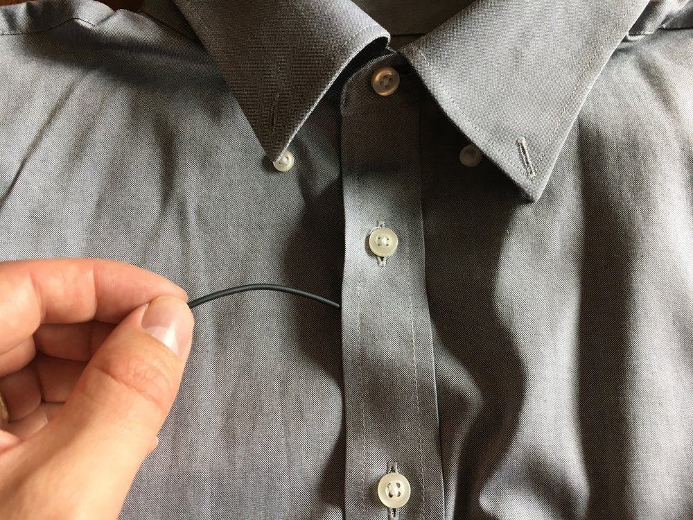 If you are miking a button up, slide the cable between the buttons at about the sternum on the chest.