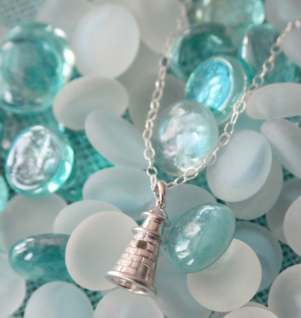 The lighthouse pendant by Penny James Jewelry Co. is the perfect piece to wear while sightseeing in the Outer Banks!