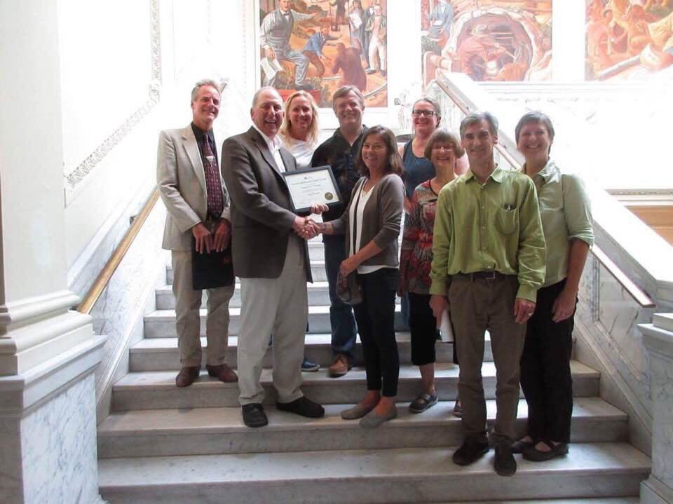 Sturgeon Bay Historical Society members receive Historic Designation for the Teweles and Brandeis Grain Elevator from the State Historic Preservation Office, Madison, WI