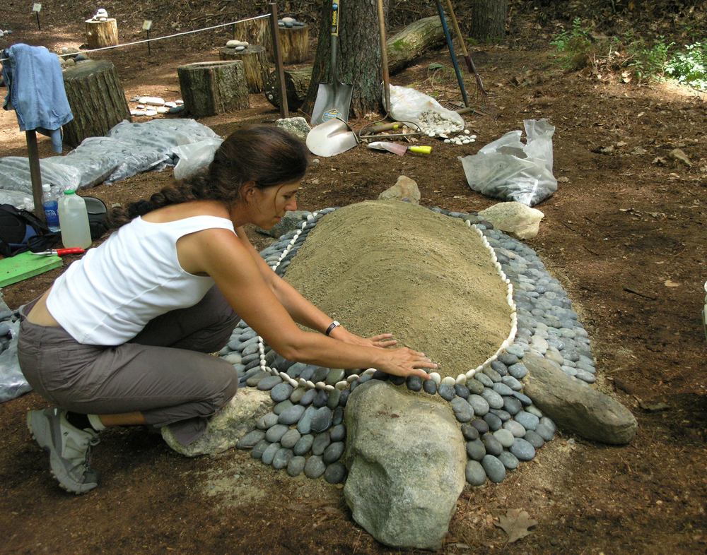 LH making a stone turtle in 2006 for Garden in the Woods, Framingham, MA