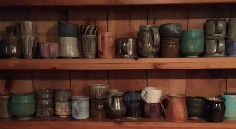 Mug , Alex Matisse, fourth from right on bottom shelf