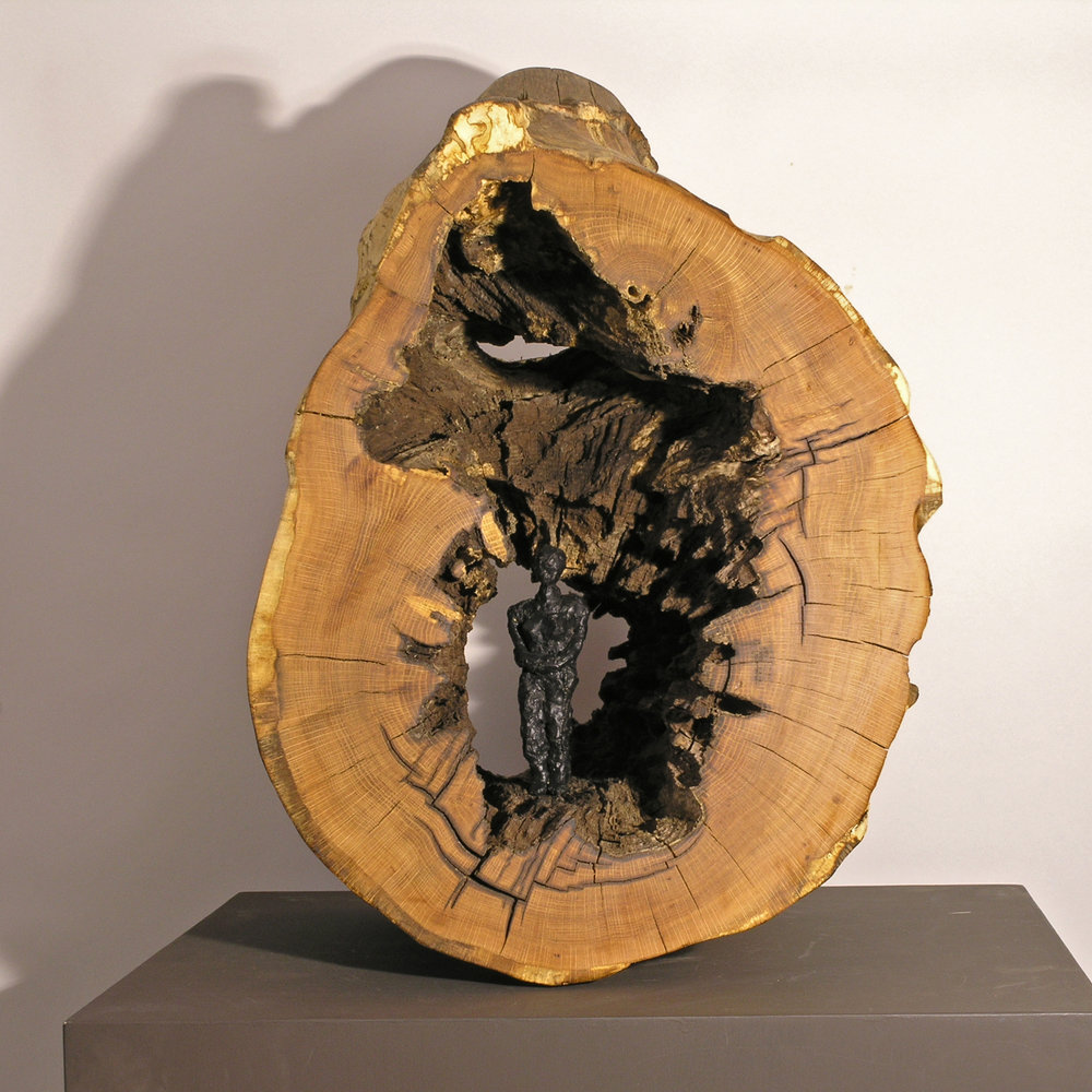 Woman in Log , bronze figure and wood, LH