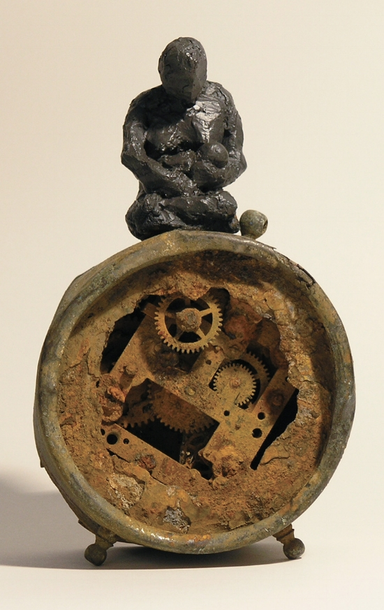 Nursing TIme, Bronze figure and rusty alarm clock, LH