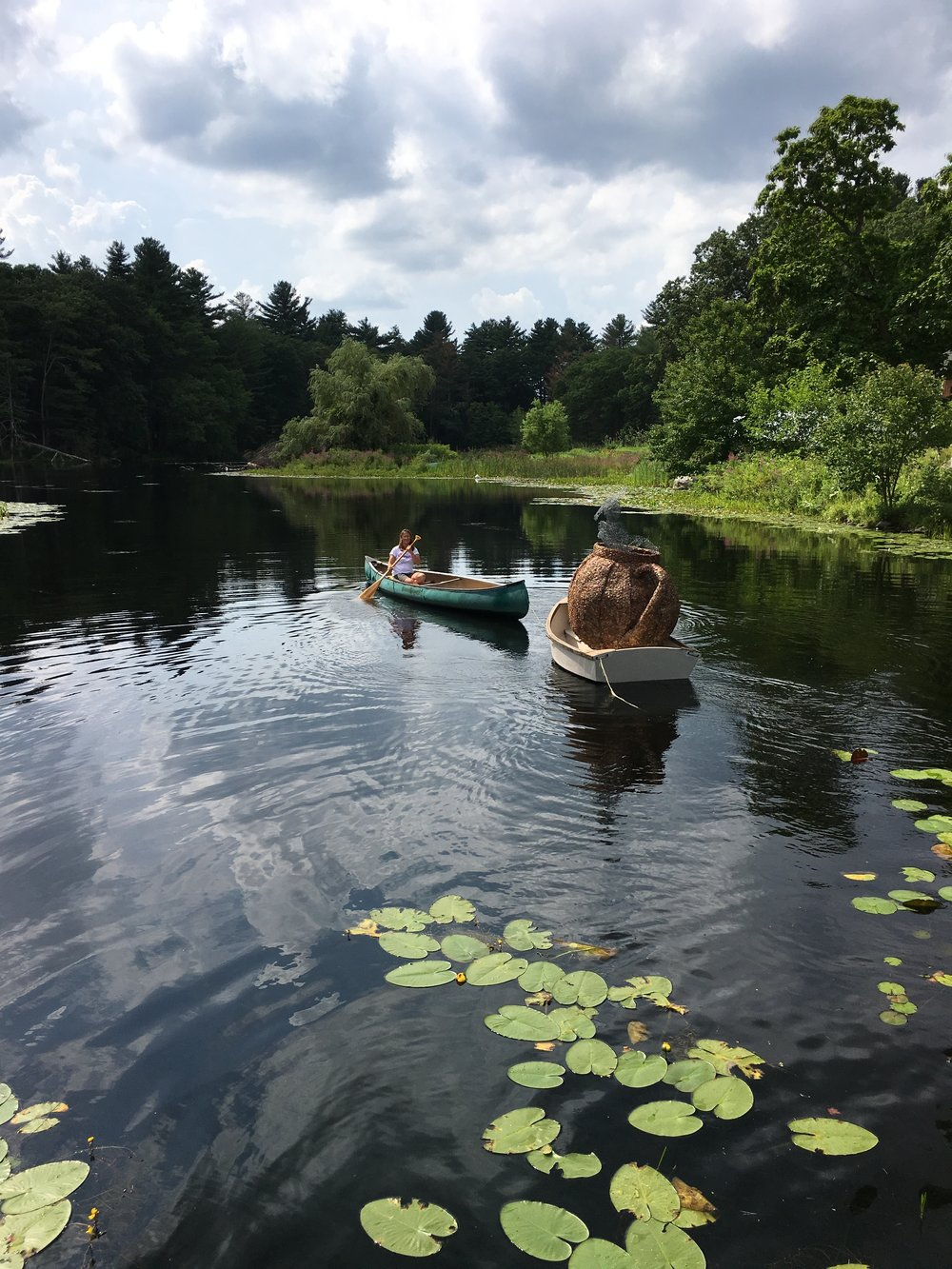 Gabi in the canoe taking our sculpture for a tour of the pond.