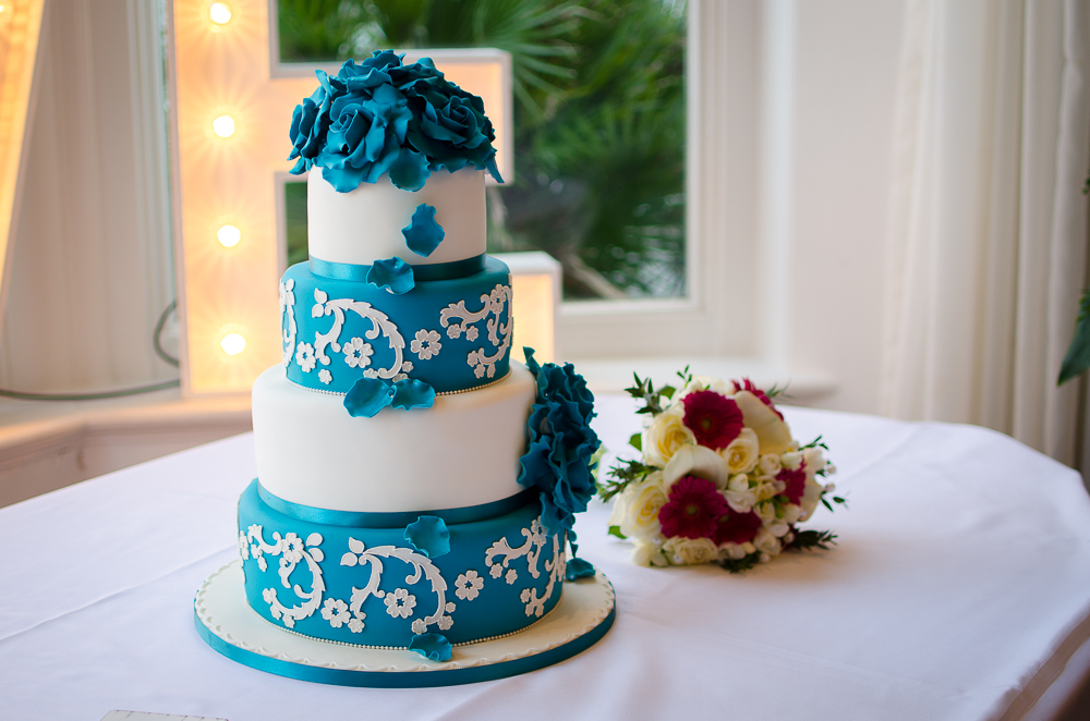 wedding cake with a bouquet