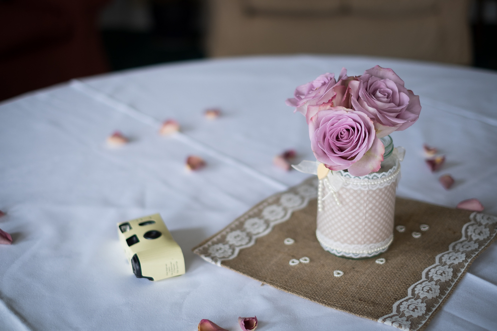 a vintage flower and a disposable camera at the reception venue