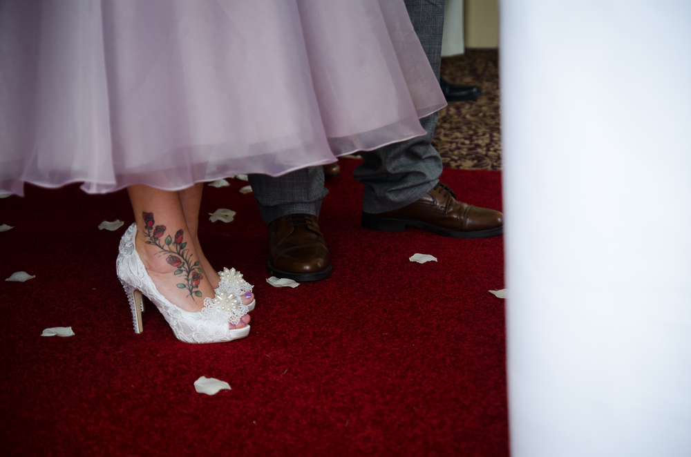 the vintage shoes with a rose tattoo along her ankle