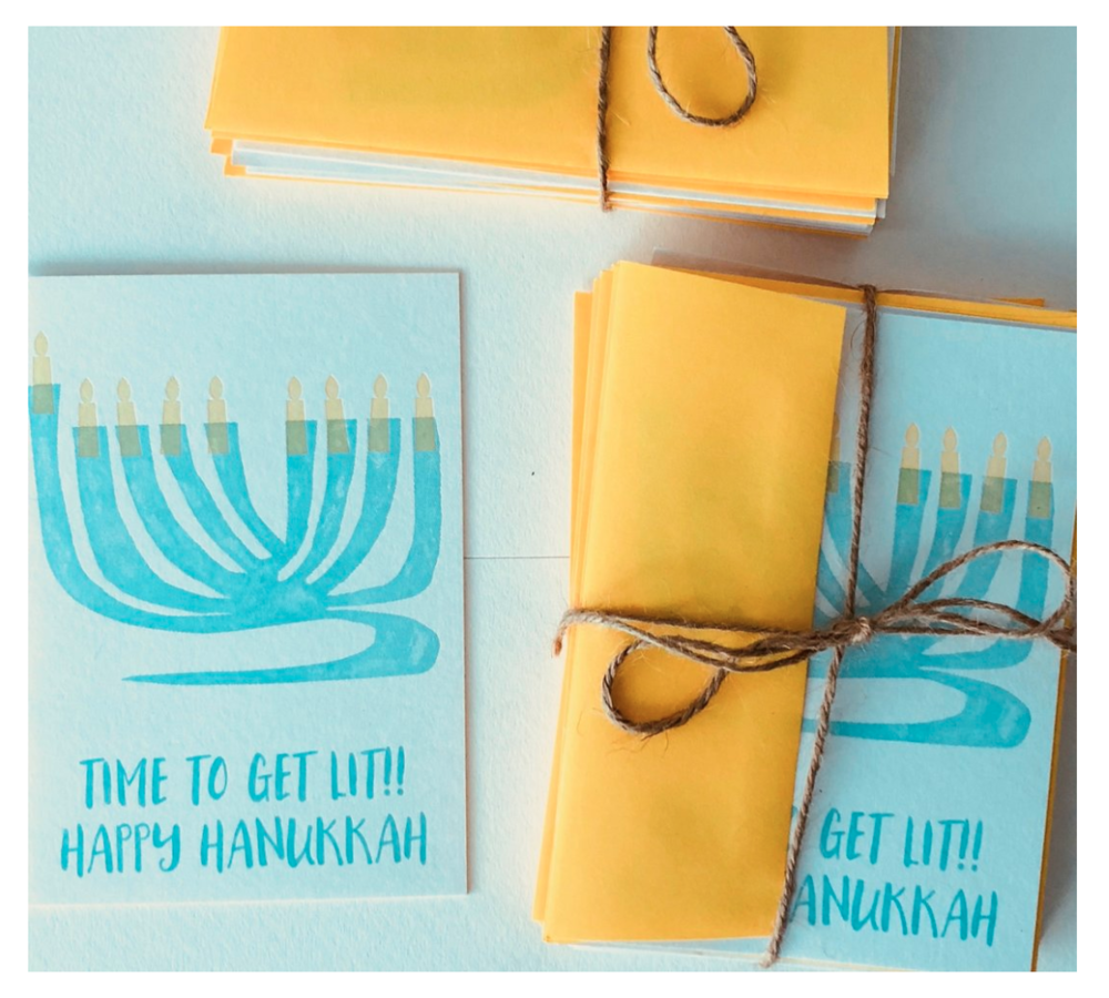 A letterpress Happy Hanukkah card on beautiful white thick card stock with a coordinating envelope.