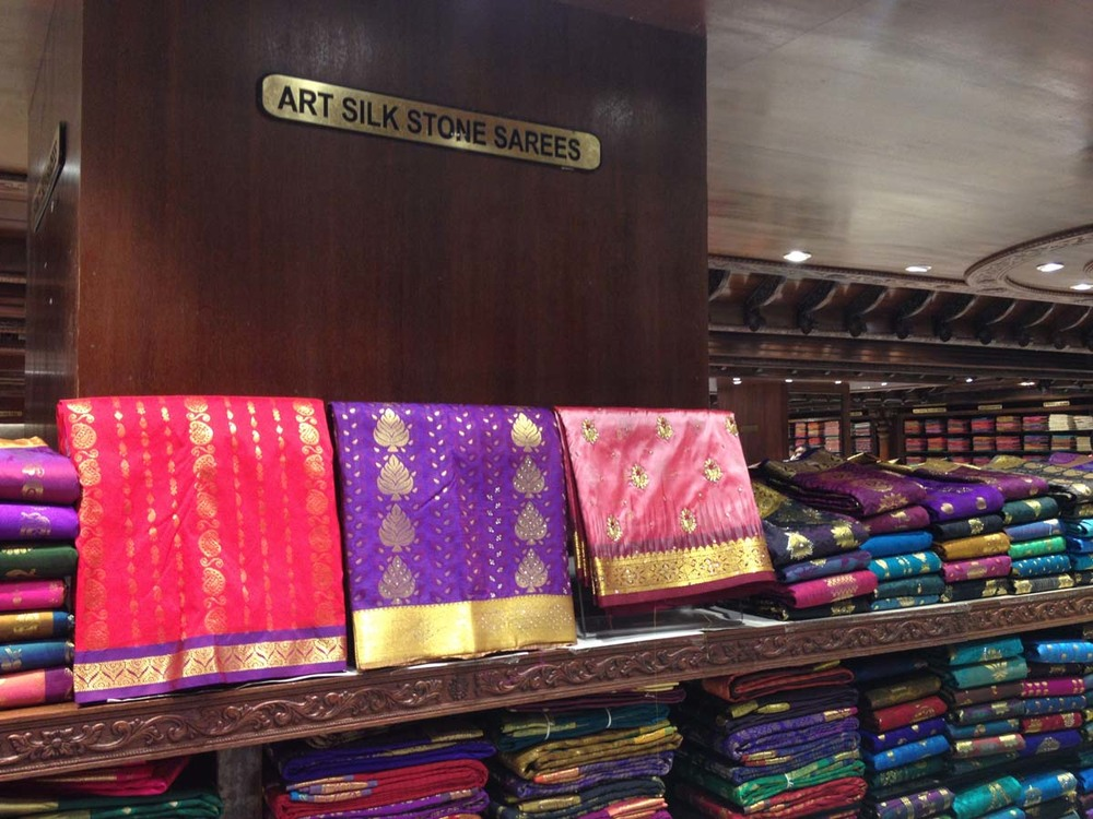 All silk saris with beautiful gold borders and printed designs. Pure luxury for the wealthier crowd.