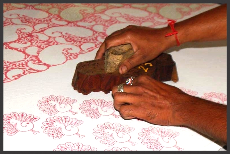 Prints are applied with wooden blocks, carved with care. Lightly placed on a paint covered sponge and then gently stamped on to the cotton fabric. Lining up the designs so no overlapping occurs the stamping is done with precision and speed.