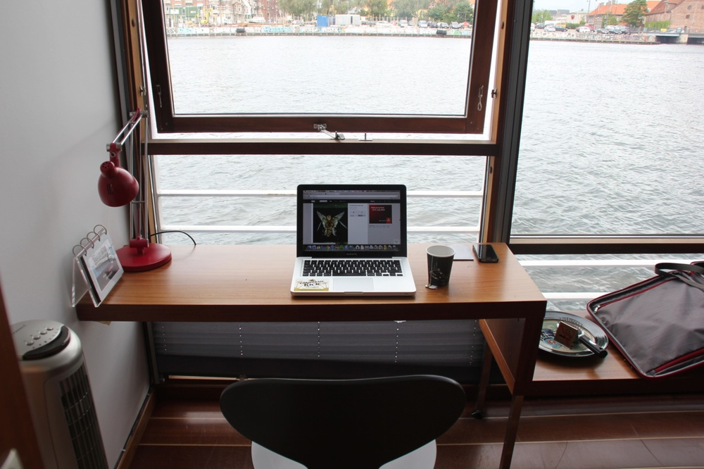 home-offices-fashionable-workspace-design-with-two-legs-wall-mounted-wooden-desk-and-cool-red-desk-lamp-also-views-over-the-water-11-modern-workspace-designs-with-beautiful-views.jpeg