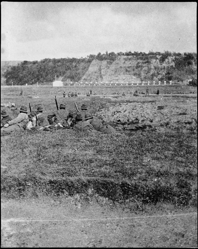 Figure 4: The flat land on the northern bank of the Manawatu River was used as a rifle range for troops training for the First World War. In the distance are the cliffs of soon-to-be ANZAC Park, circa. Reference: Pataka Ipurangi 2009N_A30_WAR_2196, Ian Matheson City Archives.