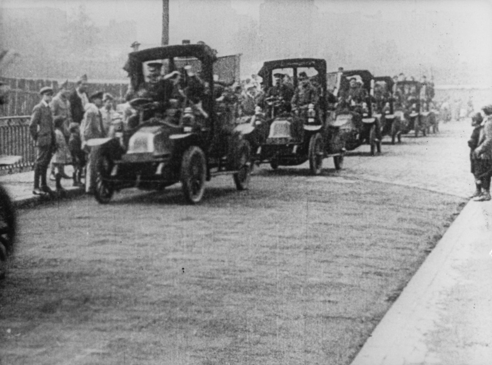 "Figure 6:  Renault Type AG1's line up in France to take troops to the Marne battlefield in September 1914. Reference: WWI Canada. ""France recalls centennial of 'Taxis of the Marne,' desperate operation to save Paris in the First World War"". URL: http://ww1.canada.com/"