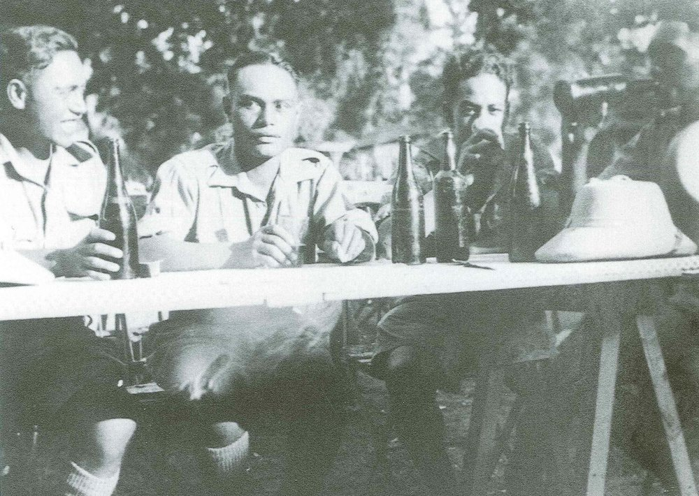 "Figure 5: After they were withdrawn to Egypt, the men of 28th Māori Battalion were given seven days' ""survivors' leave"". Matarehua Wikiriwhi (far left) enjoys a few beers with Mahuika Waerea, Henry Mathews and Moana Ngarimu. All were part of the intelligence section of Battalion Headquarters. Source: Monty Soutar, Nga Tama Toa – The Price of Citizenship, pg 157."