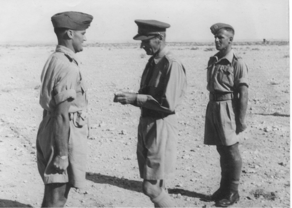 Figure 6: Bob Horrocks receiving his ribbon for his Military Cross. Keith Elliott (right) has just been awarded the ribbon to his Victoria Cross by Lieutenant-General Montgomery. Source: Auckland War Memorial Museum, Online Cenotaph, 'Keith Elliott'. URL: http://www.aucklandmuseum.com/war-memorial/online-cenotaph/record/C35235