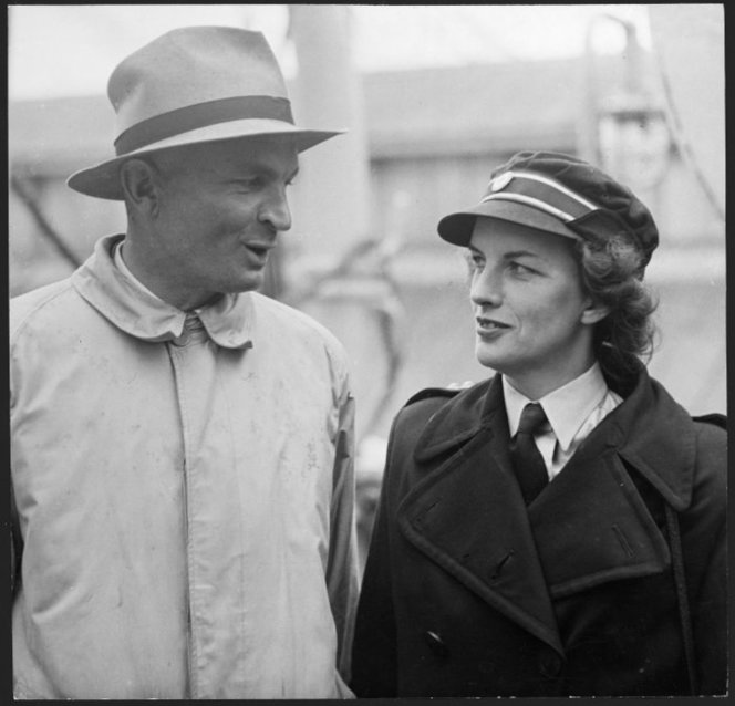 Figure 9: Photograph taken 20 December 1945 of Captain Charles Upham meeting his wife at Wellington Harbour after arriving aboard the  Mooltan  from England, where she served in the British Red Cross. Source: Alexander Turnbull Library. Reference # EP-NZ Obits-Upham-01. URL:      https://natlib.govt.nz/records/22786535