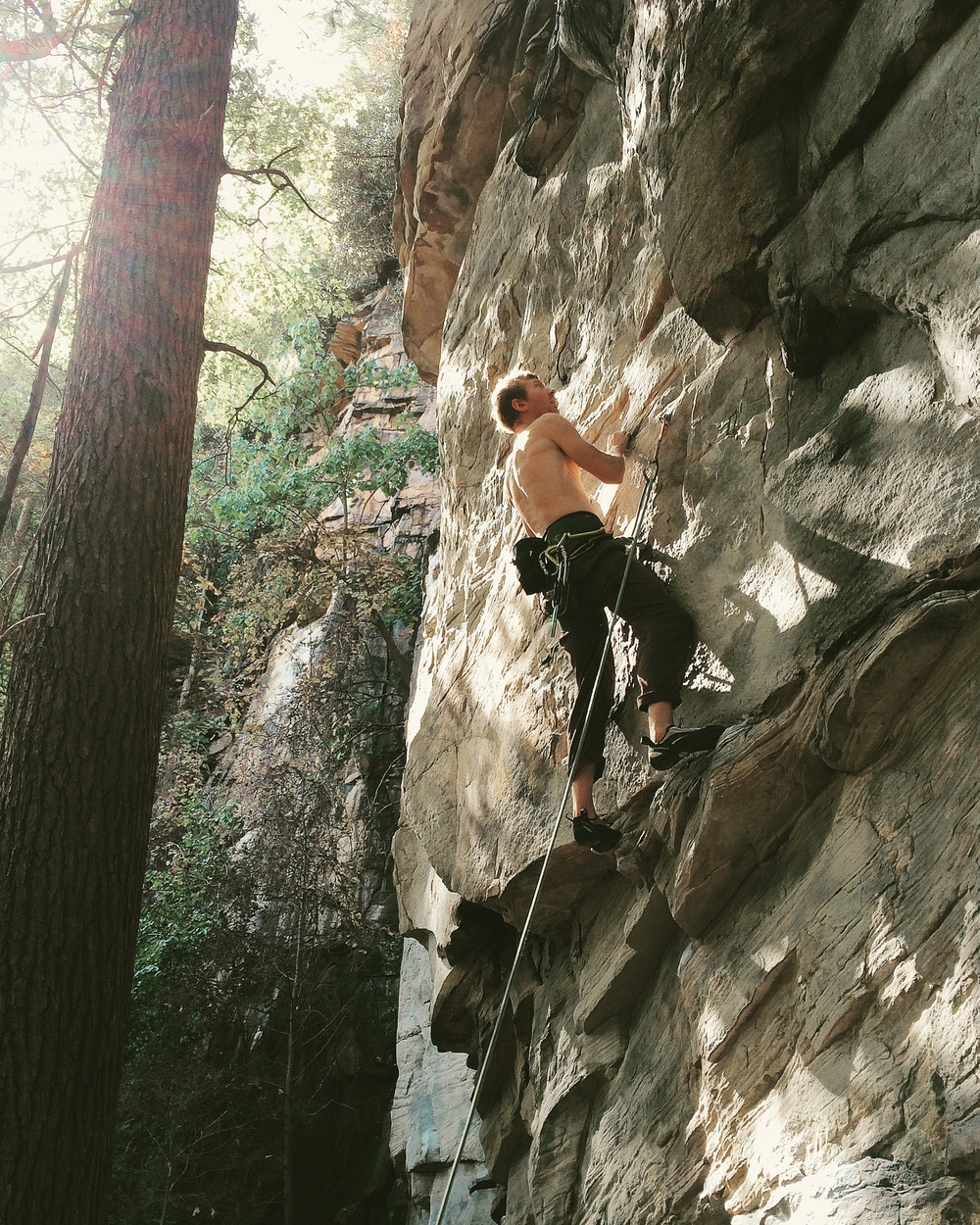 Brian working the moves on Bimbo Shrine (11b/c) at the 7 Eleven Wall in Kaymoor