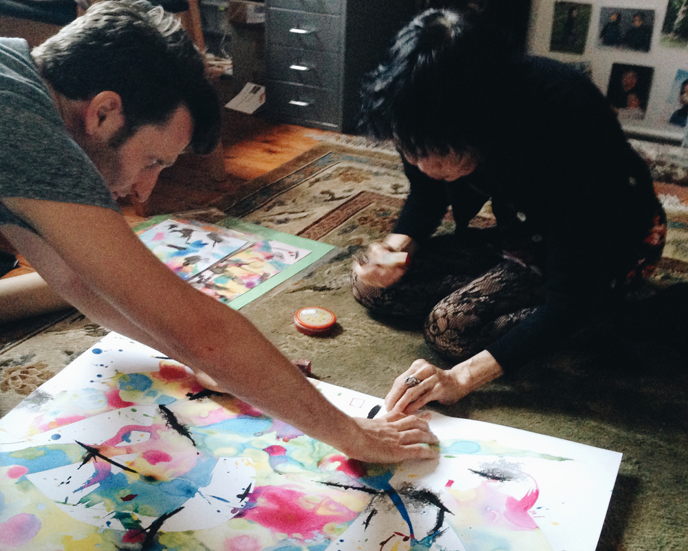 MaeWan signing her painting.