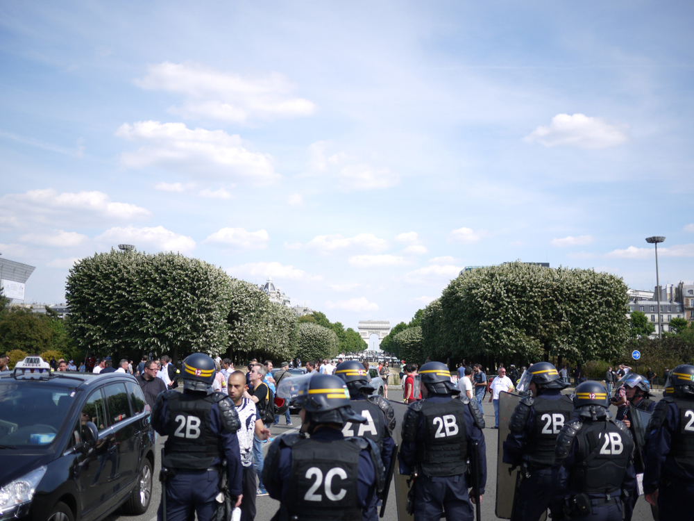 http://techcrunch.com/2015/06/25/french-anti-uber-protest-turns-to-guerrilla-warfare-as-cabbies-burn-cars-attack-uber-drivers/#.dlih31:nrMh