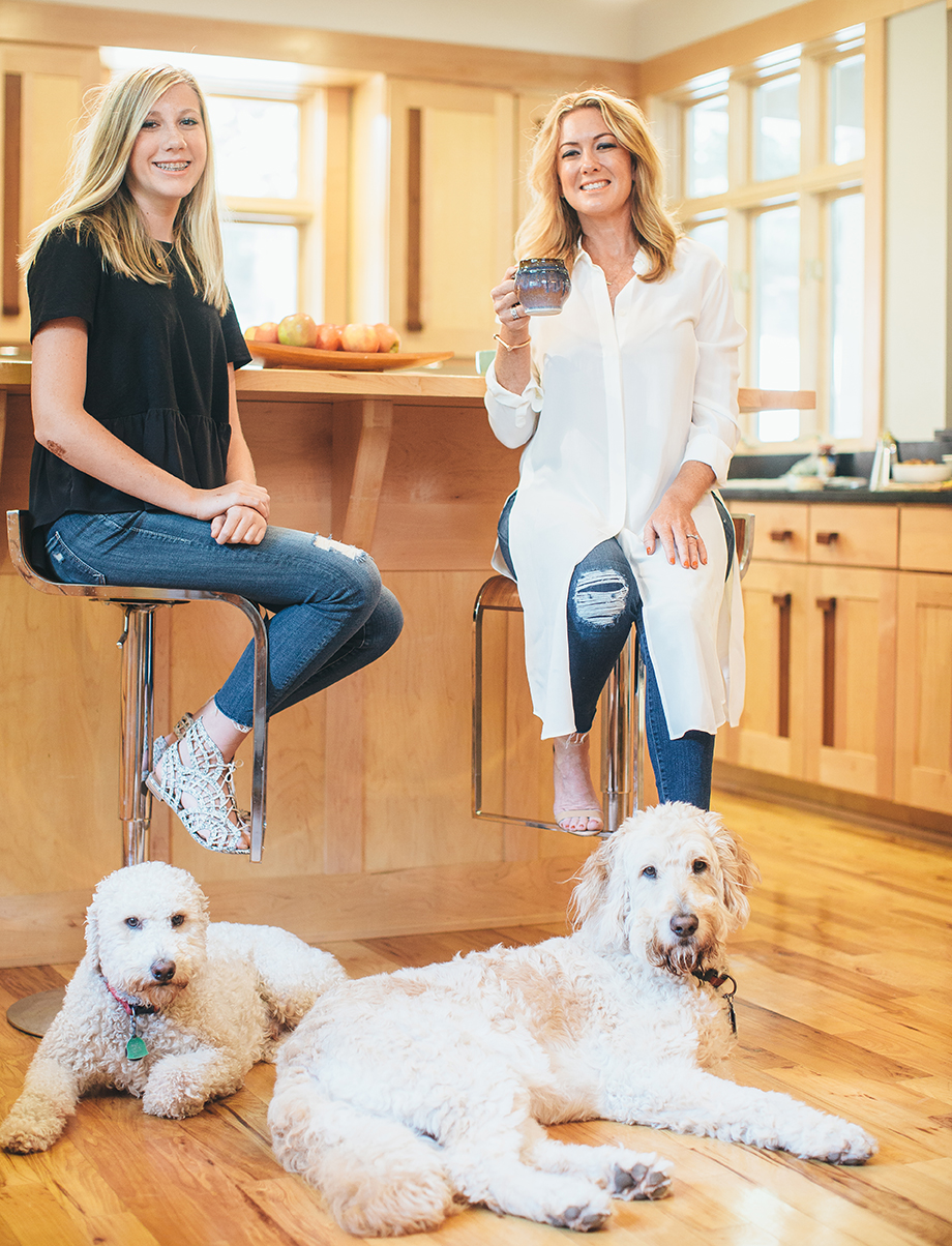 Jen Lewis and daughter, Ella Kate, in the kitchen with the family's goldendoodles, Oliver and Hunter.  Photo by Novo Studio