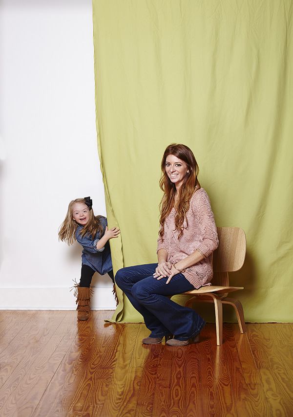 Khloe plays peek-a-boo with mom Kristen at the shoot. Photo by Lily Darragh.