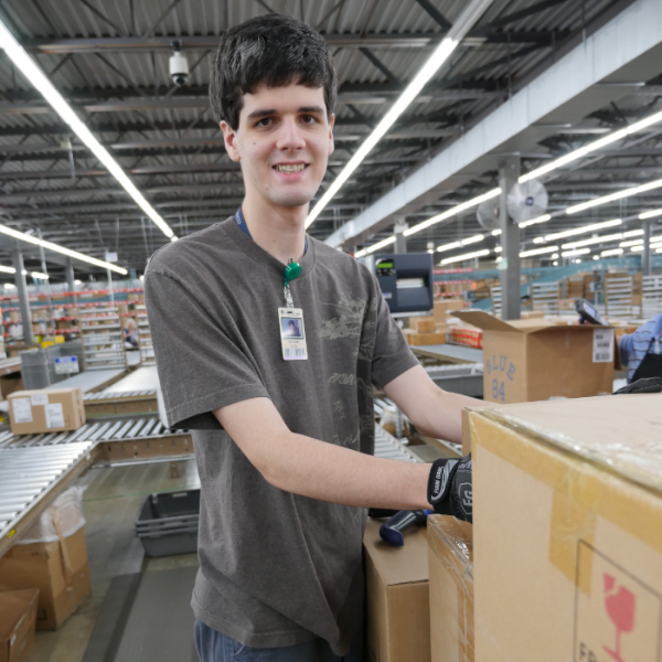 After graduating from the program, Devon now works in the distribution center at Dillard's.