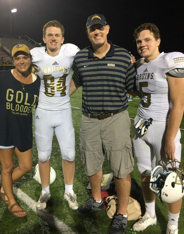 Jenny, Hudson, Mark and Hayden after an away game playing for Pulaski Academy in 2016.
