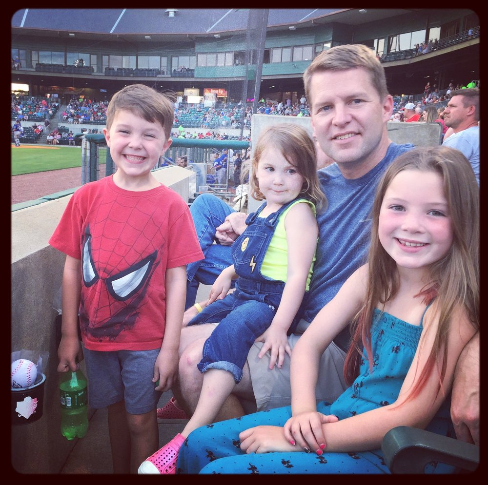 The kids getting some quality dad time at a Travelers game