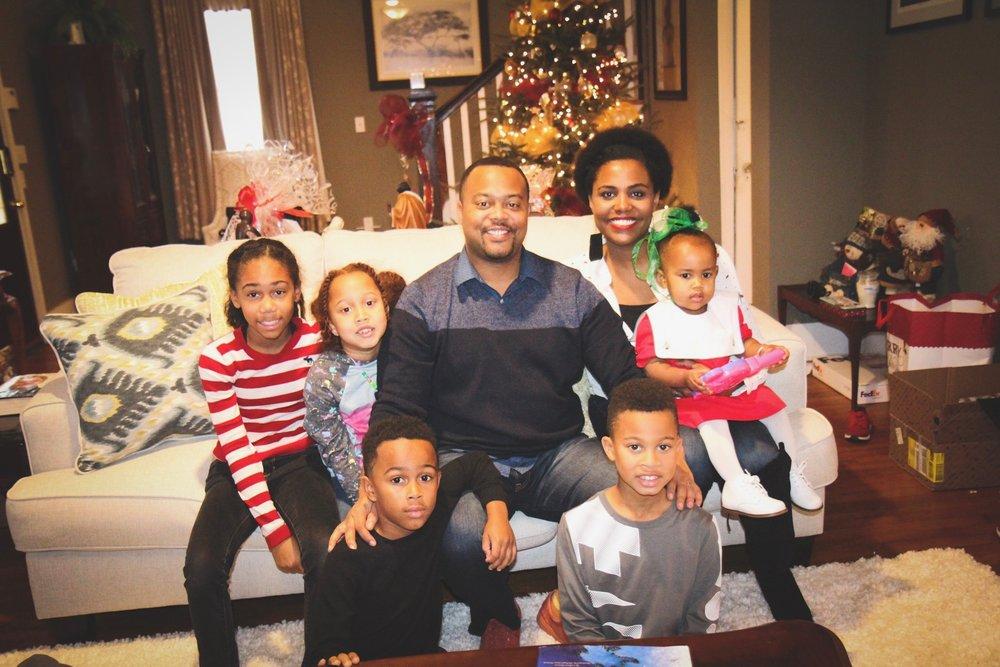 Chloey, Elizabeth, Ari, Charles, Charles III, Ganelle and Bronx celebrating Christmas.