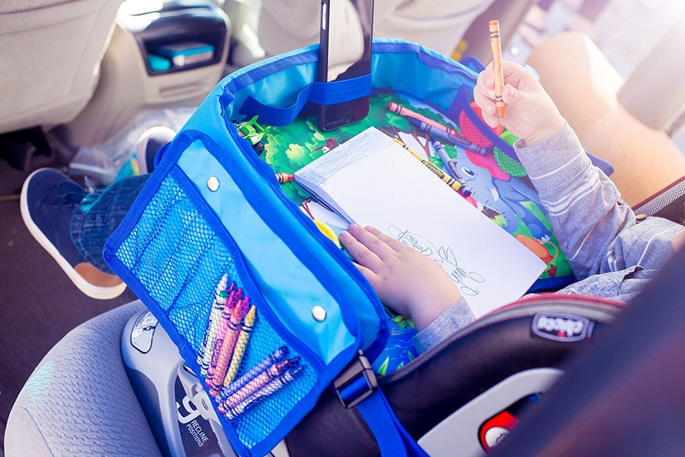 Save yourself from reaching in the backseat constantly by setting up a travel tray with everything your little one needs within their reach.