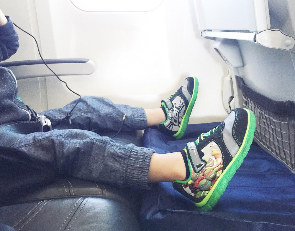 Bring the gear that works for you. They loved sleeping on Flytot, an inflatable bed for the airplane.  A note on long flights: This will play out worse in your head than in real life. Pre-order kids' meals; download movies; pack snacks, extra clothes, first-aid kit, kid headphones and surprise toys.