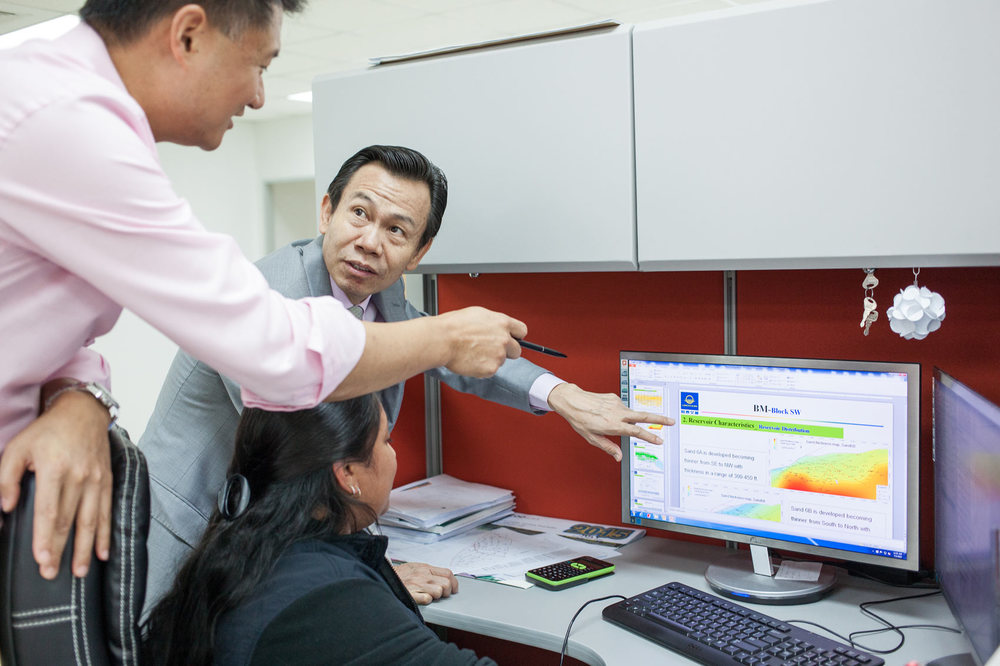 LandOcean chairman Gwengwen Sun and partner David Chen review data at San Fernando headquarters.  Photo by Mark Gellineau