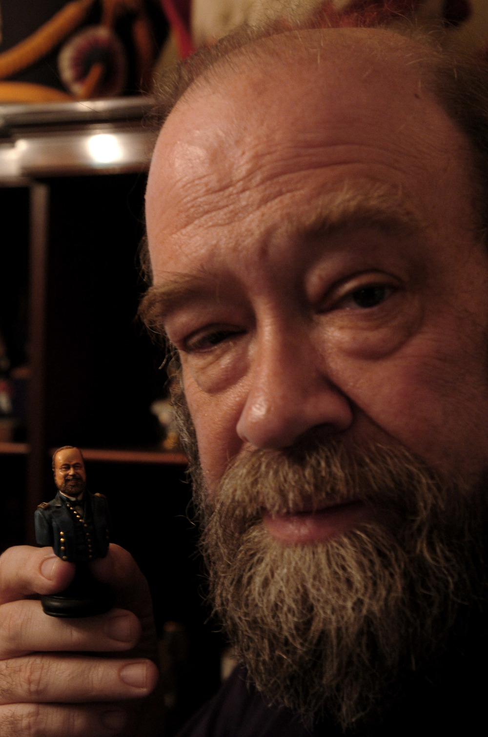 Shep Paine with a miniature bust in his likeness, a gift from one of his many friends and admirers. (Photo by Marty Perez, 2008)